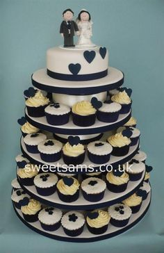 Navy And Ivory Cupcakes On Bespoke Cake Stand Finished With  cakepins.com