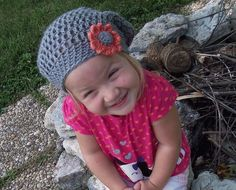 Slouchy Hat For Children ~ Free Pattern.  Just made this for one of my nieces.  Worked up in just 2 1/2 hours!  Changed the flower though.