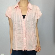 River Island pink button up top - Condition: Great condition - Flaws: none - Material: 100% cotton  - Color: pink - Size: 16  - The person in the picture normally wears a medium   - no trades - no PayPal - bundle for discount River Island Tops Tees - Short Sleeve