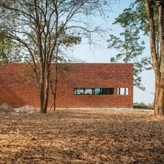 Layers of brick, concrete and glass define private spaces in a Thai home