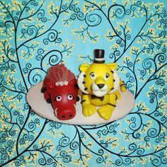 lady...just say neaux!!     Customized Animal Wedding Cake Topper. $75.00, via Etsy.