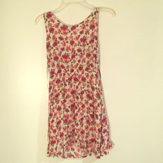 Forever 21 sundress  Floral and fun Forever 21 sundress, worn a few times, but is just a little too short on me now.. Has a really fun back tie cut out! Open to offers!  Forever 21 Dresses Mini