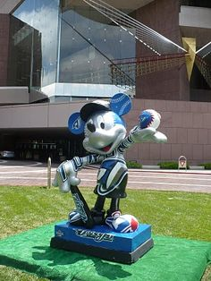 Mickey Mouse wearing his Toronto Blue Jays uniform in front of Segerstrom Hall. To celebrate the All-Star game being played at Anaheim's Angel Stadium on July 13, 2010, 36 Mickey Mouse statues were decorated with graphics featuring each of the Major League clubs as well as four All-Star designs, and an American League and a National League design. Each statue stood 7 1/2 feet tall and weighed 989 pounds.