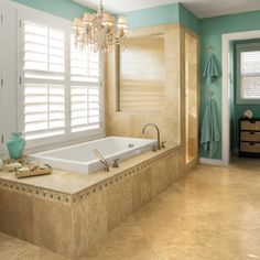 Choose a Signature Color    Be bold in your color choice. The vibrant aqua wall color in this master bath is picked up in the accent tile and accessories. (Southern Living)