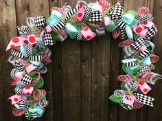 A personal favorite from my Etsy shop https://www.etsy.com/listing/529297105/mad-hatter-garland-deco-mesh-garland