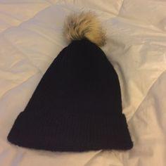 New black beanie cap w/ Pom Pom Brand new in black with tan and black Pom Pom Accessories Hats