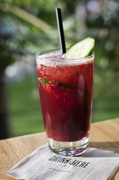Port of Call from Marina Kitchen. This cocktail is made with Quinta do Noval Black Port, Muddled Strawberries, Lemon Juice, and Soda Water. #sandiego #drink