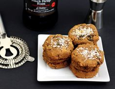 Rich raisin and macadamia molasses cookies spiked with blackstrap rum. Made with coconut flour, grain free, and refined sugar free.