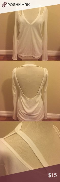 Sweater with cut out details Cute sweater with cut out shoulder details and dramatic low back. Dress it up with some heals or go more casual with a pair of distressed jeans! Only worn once. Tobi Sweaters V-Necks