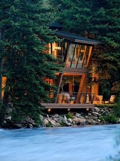 River House Glows Like a Lantern in the Woods - under deck lights give Dining Room guests a view of the river and landscape from the angular windows. Architecture by David Johnston Architects, Aspen, Colorado. - My dream home! Twilight House, Architecture Design, Angular Architecture, Contemporary Architecture, Windows Architecture, Contemporary Building, Sustainable Architecture, Landscape Architecture, Landscape Design
