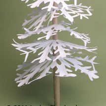 How to assemble the layers of branches on a miniature tree made from cut paper snowflakes.