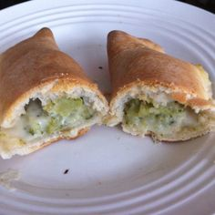 Pizza dough stuffed with broccoli and a creamy garlic cheese herb sauce