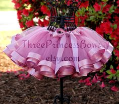 Satin-trimmed tutu by Three Princess Bows. Seems basic enough to attempt...I totally wish I could get away with wearing one of these. :D