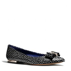 The Wendy Flat from Coach  -  fun, hand painted dots on snakeskin with nice bow.  cute!     lj