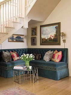 Try finding an unexpected spot for a corner banquette, as in this area beneath a staircase, which was transformed into a lush lounge ready for a cocktail party.