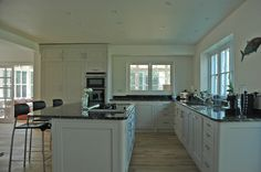 a cool and calm kitchen that overlooks water www.timjasper.co.uk