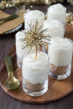 Make these fancy and easy white chocolate champagne cheesecake shooters for New Years Eve! I LOVE the gold tinsel toppers!