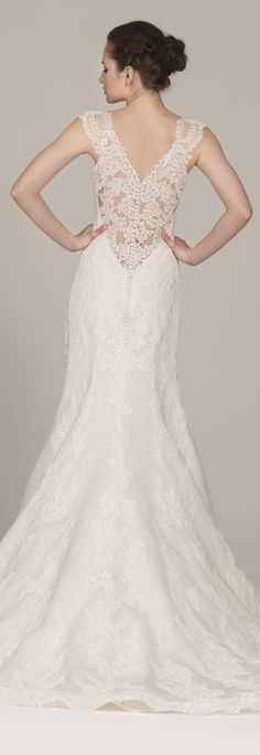Viola wedding dress by Kelly Faetanini // Fit-to-flare lace gown with illusion lace deep V back