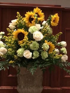 Formal flowers like roses look great with rustic, informal Sunflowers.