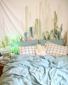 Solid Color Comforter w/ Cactus Tapestry and decorative pillows. Pastel Colors. #USUMoveIn