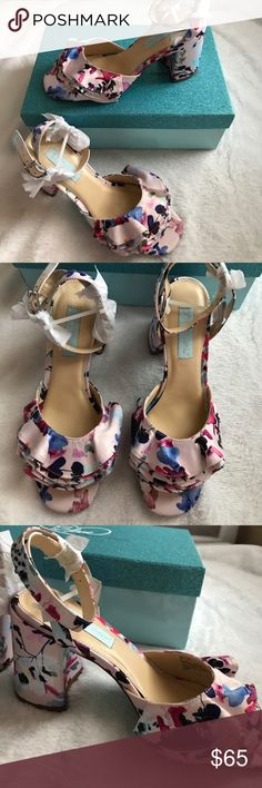 """Blue by BETSeY Johnson SB FLIRT Floral Heels 8 W Blue by BETSeY Johnson SB Flirt Floral Strappy Heels size Women's 8. New in Box and 100% Authentic. Please note these have minor flaws as pictured. Item number written on bottom as pictured. Price reflects small defect. Wrap around straps Clasp. Floral decorative ruffled open toe. Chunky 4"""" Heels. Super girly. Please let me know if you have any questions. 30% additional discount when bundling. Reasonable offers may be considered. No trades…"""