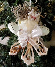 Angel Ornament with cut strawberry strombus shells by OceanBlooms, $15.00