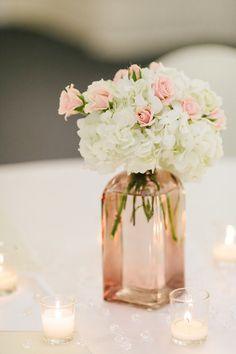 Simple wedding Centerpieces by Southern Peach Events                     Fritz Wedding  Photo By Sarah Mellor Photography