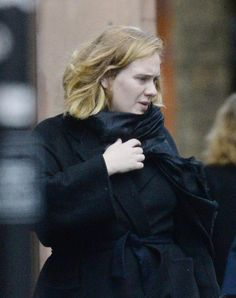 Adele goes make-up free as she heads to the shops in London