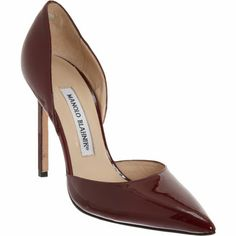 Manolo Blahnik Tayler at Barneys.com. Crafted of patent leather, this pointed toe d'Orsay pump is lined in smooth leather and finished with a thin, square heel.