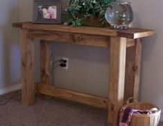DIY Furniture Plan from Ana-White.com  This rustic solid wood console table is built from standard 2x4 boards. With a rustic stained or a distressed finish, you can have your very own stylish console table in just a few hours. Featuring a stretcher and sturdy design, with breadboard ends. This well thought out plan has been built hundreds of times succesfully, even extended in length and width.