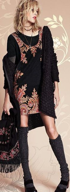 LAYERS, BROKEN LINE (shoes.socks, skirt, layers, necklace, cape all contribute), MULTI-TEXTURAL, MINI, FRINGE, SCROLLY/PAISLEY/STYLIZED FLORAL, slightly EXOTIC but EDGY, WRAPPED (or stacked) necklace. Free People