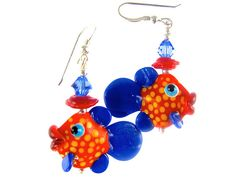 These exquisite glass bead fish earrings handmade with artisan lampwork glass beads. The beads are red base with yellow dots and royal blue tail and fins.