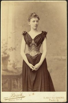 """""""Young woman in dark dress with elaborate corselette. Unidentified, possibly relative/friend of Gertrude S. Kunhardt."""" Photograph by Van Bosch, Paris, c. 1890."""
