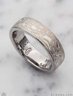 Our most popular mokumes is our White Mokume Gane is made up of layers of 14k palladium white gold and sterling. Design your own mokume band by choosing your favorite mokume, metal and width!