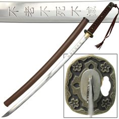 The Traditional Japanese Handmade 1045 Carbon Steel Sakura Samurai Katana is full tang with a double pegged wooden handle. The handle is wooden wrapped in black faux ray skin with a traditional brown cotton wrapped Ito. #traditionalsakurajapanesehandmadefulltangsword