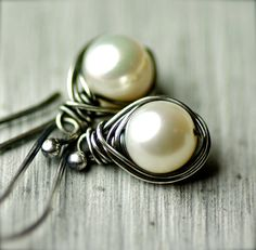 White round freshwater pearls were wire wrapped and hang from sterling earwires. These earrings are simple and pretty! All of the sterling silver has