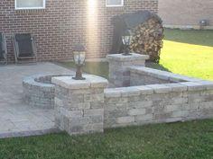 Backyard patio, stone wall, lights