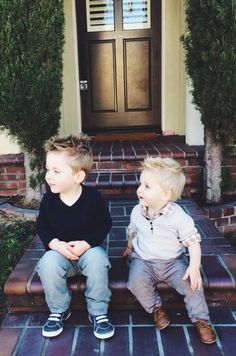 Rugged toddler boy style, layers, v neck shirts, and solid colors in a neutral palette