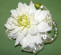 I like how it is attached to a real bracelet that can be a keepsake. White Dahlia Wrist Corsage