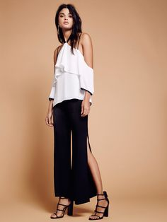 Kirsten Set | Undeniably effortless and oh-so-chic set.    * Off-shoulder tank with an around-the-neck halter tie detail and a femme flowy shape with a ruffled overlay. Lined. Thin straps attached for an easy fit.    * High-rise pants feature a flared shape with an ultra silky feel and dramatic front slits for a sexy, modern touch. Hidden back zipper closure.