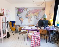 white floor | map | chair | purple table