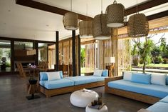 Its a toss between a Bali themed house or Spanish house.  I like the airy feel of the Bali houses