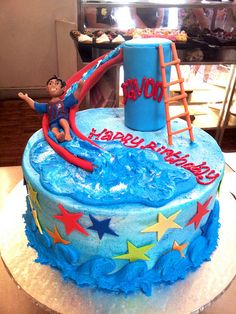 Wicked Chocolate cake iced in sea blue butter icing, decorated with 3D waterslide with 3D boy figurine in Barcelona FC t-shirt & bright fondant stars by Charly's Bakery, via Flickr