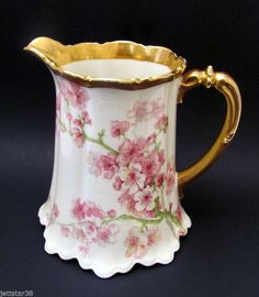 ANTIQUE LARGE LIMOGES MILK OR WATER PITCHER..APPLE BLOSSOM DECORATION..MAVALEIX FACTORY MARK 1908...This auction features a beautiful & large Limoges Water or Milk Pitcher with Apple Blossom decorati
