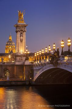Pont Alexandre III with Hotel les Invalides beyond, Paris, France. by Brian Jannsen