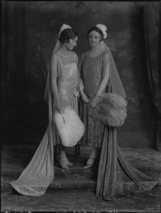 A belle epoque tiara, worn bandeau-style. Photo taken in 1926.  Lady on the left  is being presented at court.
