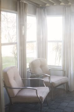 $10 a piece outdoor drapes - get 6'x9' canvas painters drop cloths at Home Depot, ring clips & hardware. Wash, dry, iron, hang. Tada! >>click through for tutorial