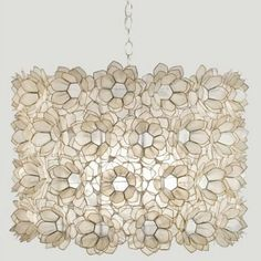 Capiz Shell Floral Chandelier with Natural Off White Rosettes by Worlds Away exudes lavish, out of the ordinary design. Natural hue adds depth to this stunningly detailed lighting.