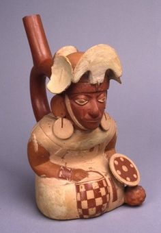 Moche vase (in form of seated warrior; stirrup spout) made of pottery.