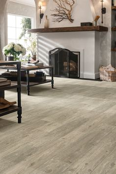 Our Shaw Floors DuraTru ARES | TRICCA is vinyl flooring made to make your life easier. Click to learn more and get a sample. Stucco Fireplace, White Fireplace, Farmhouse Fireplace, Fireplace Remodel, Fireplace Design, Fireplaces, Simple Fireplace, Farmhouse Flooring, Fireplace Ideas